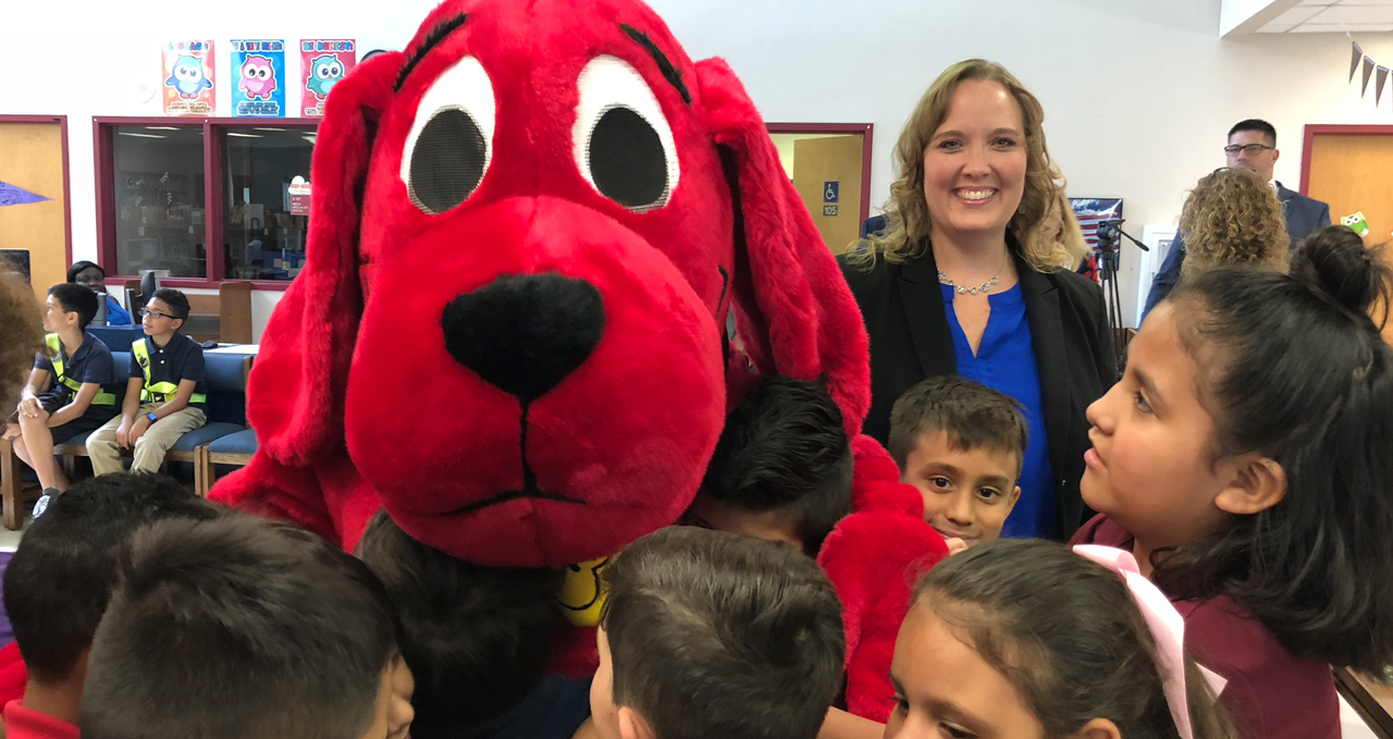 CEO Dr. Lisa Williams-Taylor with Clifford the Big Red Dog and children