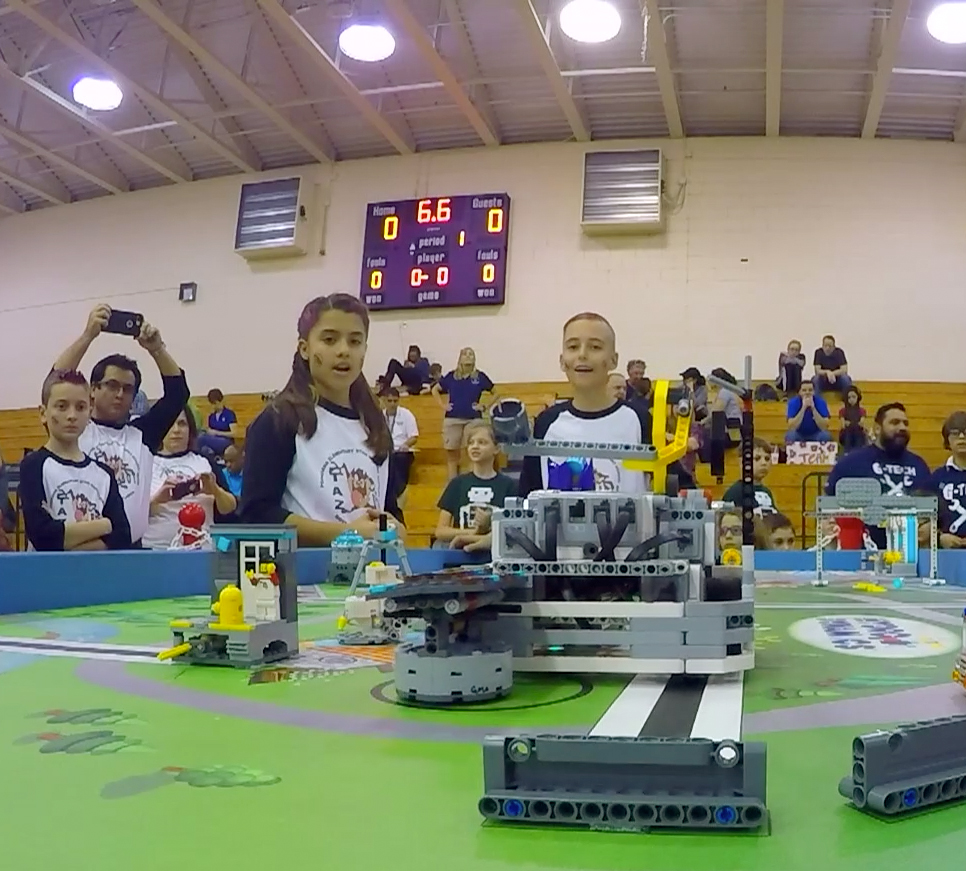 Children competing in Lego block competition.